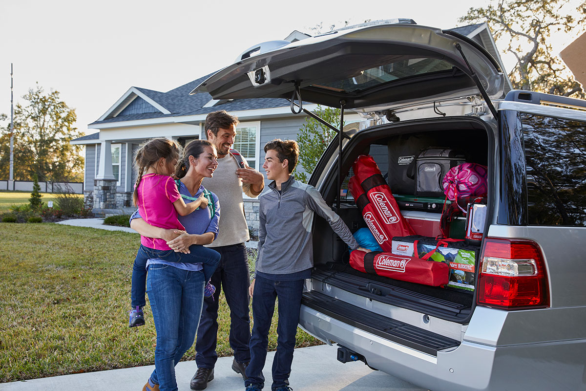 Family packing minivan with Coleman products